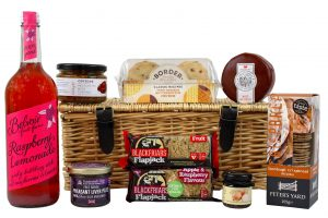 A Traditional wicker picnic hamper basket full of luxury foods ready to just take away on a picnic with UK Delivery.