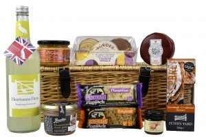 Picnic Gift Hamper filled with a delicious choice of foods, many award winning and presented in a traditional wicker hamper basket.