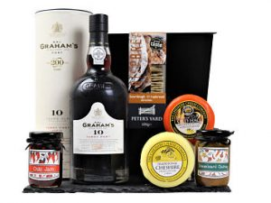 Make the Cheese and Port Gift Hamper personal, by adding your favourite flavours of the Award Winning Cheshire Cheese Companies cheese truckles and Handmade Hampers chutney to accompany the carefully selected ports and Peter's Yard Great Taste Award Winning sourdour crispbreads. A tasty box full of Award Winning favourites.