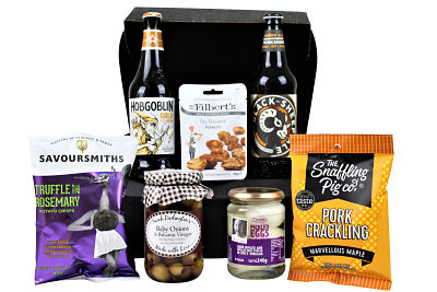 The Pub Classics Beer Gift Hamper is a collection of all the old favourites but brought right up to date with a touch of luxury added. Award Winning beers and lager of your choice. Sarah Darlington's baby onions, pickled eggs in a spicy vinegar, Mr Filbert's nuts, Savoursmiths luxury hand cooked crisps and not forgetting The Snaffling Pig pork crackling. The perfect gift for any pub lover!