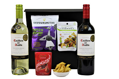 This Sauvignon Duo - Wine Gift Hamper includes a two Award Winning bottles of wine to accompany some delectable treats.  Choose your preferred flavours from our delicious hand cooked luxury crisps, really interesting Mr Filberts nuts and Award Winning chocolates and truffles.