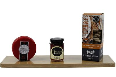 Select your cheese from our award winning range and combine it with a chutney. A box of award winning crispbreads complete the trio with this magnificent cheese gift hamper.
