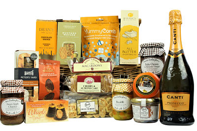 The Cotswold Picnic hamper basket is crammed full of luxurious delights for that perfect picnic treat. Cheshire Cheese Co. waxed cheese truckle, flavoursome pate, artisan Peter's Yard crackers.  Dean's biscuits, Deliciously Ella chocolate nuts and YummyComb indulgent honeycomb to name but a few.  Choose your preferred bottle to make this basket complete for the perfect picnic treat.