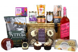 A Picnic basket hamper full of picnic food just packed up ready to be taken away and enjoyed somewhere scenic.