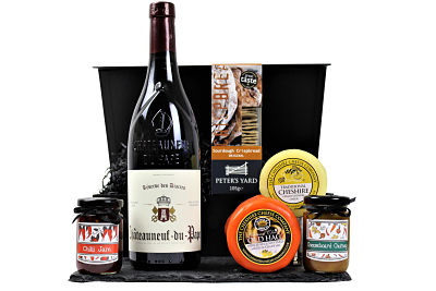 The Cheese and Red Wine Hamper is the perfect gift of your own creation. From our superb Award Winning range from The Cheshire Cheese Company, choose your two favourite flavours of cheese, add two Handmade Hampers chutney's or pickles to accompany the artisan Peter's Yard crispbread before selecting a delicious full bodied fruity wine from our collection to make the perfect gourmet gift A celebratory box of delights for any occasion.