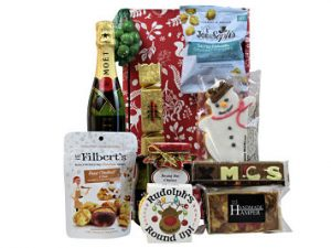 Send a small token of festive spirit with A Christmas Carol Gift Hamper. Choose your favourite bottle to accompany the Yuletide treats nestled inside this Christmas themed gift box. Festive treats such Burt's Santa biscuits, Ananda's Rudolph's round up marshmallow wagon wheel. Mr Filberts award winning nuts, Joe&Sephs gourmet popcorn and much more.