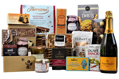 Send your friends and loved ones a little bit of Christmas cheer with the Deck the Halls Christmas Gift Basket. A festive hamper filled full of delicious Christmas treats, Luxury Christmas pudding. Lottie Shaw's mince pies. Thorntons rich chocolate biscuits, fruity festive chutney, nuts, sweets plus much more. A winner on anyone's gift list.