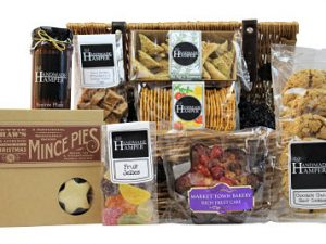 The Joy to the World Christmas Gift Hamper is filled full of delicious sweet and savoury treats. Biscuits, cake, mince pies and flavoursome chutney to name a few this gift is brimming full of treats to delight any recipient. Presented in a traditional willow hamper basket and finished with gold Christmas ribbon. The perfect way to send some Christmas wishes.