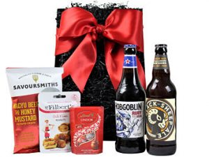 The Beer and Nibbles Gift Hamper is a not one to be missed. Choose your favourite tasty snacks to accompany these Award Winning bottled brews with the Black Sheep Brewery amber ale and Wychwood Brewery Hobgoblin ruby beer. A delightful gift on anyone's present list.