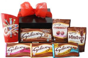 Galaxy Chocolate Gift Box. Filled with all your favourite galaxy chocolate Celebrations Tub 245g Galaxy Counters 112g Galaxy Minstrels 118g Galaxy Smooth Caramel Bar 135g Galaxy Salted Caramel Bar 135g Galaxy Cookie Crumble Bar 114g Galaxy Smooth Milk Bar 200g