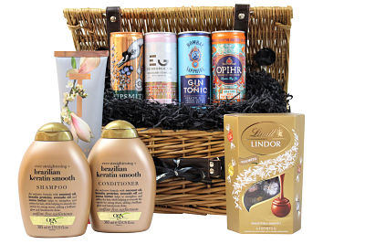 The Pamper Hamper with Gin and Chocolates is the perfect gift to spoil a loved one and make them feel extra special from the inside out. Choose your ideal selection of body lotion, OGX hair shampoo and conditioner within this pampering gift to accompany indulgent Lindt truffles and a selection of premium gin drinks. Presented in a willow gift hamper this is a gift that will delight your loved one.