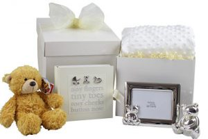 Gift box for new baby gift or baby shower. Contains teddy bear, photo frame, money box and a photo album.