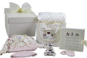 Unisex baby gift box. Contains clothes, money box, photo album and blanket.
