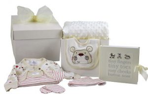 Unisex Baby Gift. Contains a blanket, outfit and photo frame.