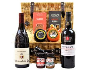The Cheese Port and Wine Gift Hamper contains a bottle of Taylor's Late Bottled Vintage Port to accompany your preferred Award Winning wine, cheese, chutney and crackers. The Taylor's LBV has all the elegance of a vintage port being full-bodied and fresh.  Choose your favourite flavour combinations within this hamper basket to make a truly stunning gift.