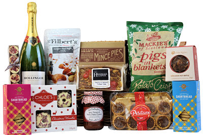 Indulge family and friends with the First Noel Christmas Basket, filled full of the perfect tastes of Christmas this will be a winning gift for all. Lottie Shaw's mince pies, rich fruit cake, Chloe's biscuits, Fudge Kitchen confectionery, Award Winning Mr Filbert's indulgent nuts and lots more. Presented in a traditional willow gift basket.