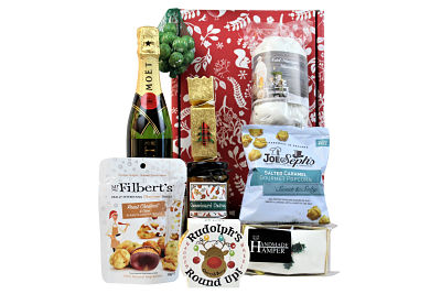 Surprise a loved one this magical time with the Holly and Ivy Christmas Gift Box. Choose your favourite bottle to accompany the festive treats inside. Traditional stollen, Mr Filbert's roast chestnut flavoured nuts. Mini iced Christmas cake, Yuletide chocolates and lots more. Add a bottle of something nice to make this an extra special gift this Christmas time.