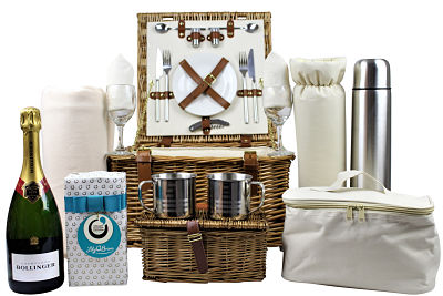 TheDeluxe Fitted Picnic Basket with Champagne and Chocolatescontains all you need for that perfect luxurious picnic treat. Willow picnic basket with cream insert and tan leather fastenings. Cups, plates, glasses, cutlery, flask, blanket along with a bottle of Bollinger champagne and luxury Lily O Brien's chocolates.