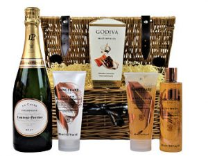 Awaken your senses with a burst of sumptuously aromatic cleansing, and give an exceptional pampering gift experience to someone special in your life with the Sanctuary Spa Pampering Basket. The refreshing infusion of essential oils and jojoba beads within this pampering gift accompany a bottle of your favourite tipple and a box of sumptuous chocolates nestled inside a willow gift hamper basket.