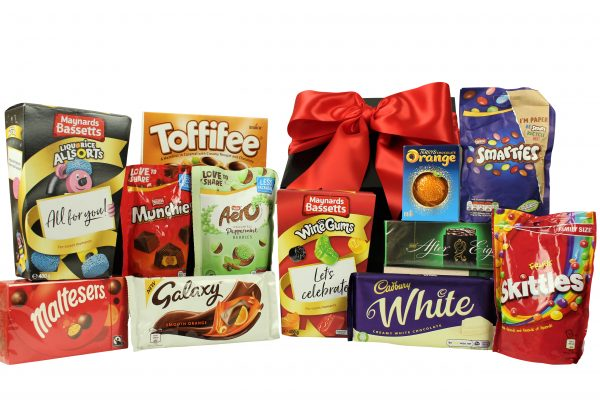 The Sweetie Gift Box is the perfect choice of gift to delight at any age. Whether you are sending to a child, grown up or the whole office! we have something to please everyone and tantilise their taste buds. Maynard Bassetts wine gums and liquorice allsorts. Terry's chocolate orange, Maltesers and After Eight mints. Galaxy and Cadbury chocolate bars and a variety of other chocolate and sweetie bags to delight.