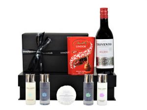 The Silver Pamper Gift Set includes a mini range of indulgent Cole & Lewis toiletries to accompany a bar of delicious chocolate and a bottle of your choosing. It may be small but will be a gift to be remembered.