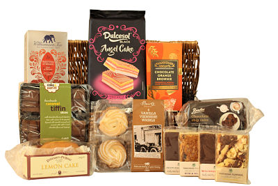Who doesn't like tea and cake! Send a basket filled with afternoon tea essentials to a loved one with the delightful Tea and Cake Gift Basket.Filled to the brim with a delicious selection of cake, flapjack, slices, biscuits and a bountiful amount of Williamson Afternoon Tea. We have included something to tempt everyone and get those taste buds dancing. Presented in either a traditional willow gift basket or a black lidded box, this is the perfect gift for any occasion.