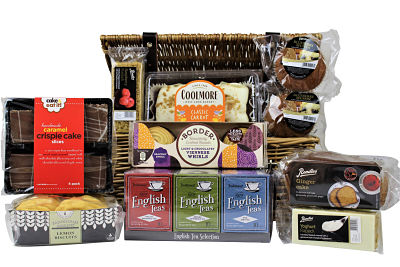 Who doesn't like tea and cake! Send afternoon tea to a loved one with the delightful Tea and Cake Gift Basket.  Filled to the brim with a delicious selection of cakes and a bountiful amount of New English Tea we have included something to tempt everyone.