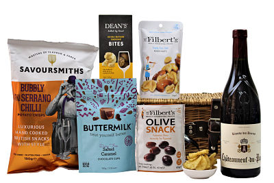 The Wine Gift Basket is filled full of sumptuous treats to accompany a the preferred bottle of wine of your choosing. Select your favourite flavours of olives, nuts, sweets and crisps to accompany an Award Winning bottle. Presented in a willow gift hamper this will definitely be a gift to be enjoyed.