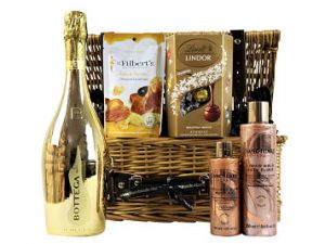 Nestled inside this willow gift basket beholds a luxurious 24k gold pampering treat.  Delicious Lindt chocolate truffles, Mr Filbert's deliciously indulgent salted caramel nut mix, decadent Bottega prosecco and pampering Sanctuary Spa Gold bubble bath elixir and body oil. An exceptional pampering gift not to be missed.