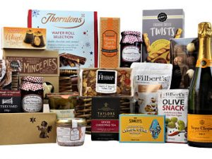 The name says it all with this gift, the Christmas Delight Gift Hamper is laden with festive fayre. Sumptuous tasty treats to awaken your Christmas taste buds. Savoury crackers and artisan crispbread. Delicious pate and mouth watering chutney. A selection of sweets and the finest chocolates. Traditional mince pies and Christmas biscuits. Add a bottle of something nice to make this the perfect Christmas gift to share.Presented in a traditional willow gift basket and finished with a gold Christmas ribbon.