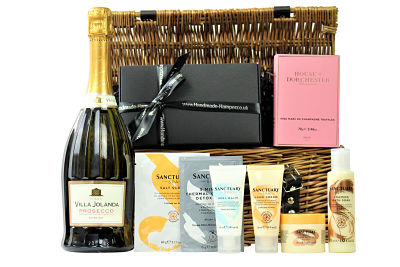 Send a gift full of indulgent treats with the Lost in the Moment Pamper Basket.Nestled inside this willow gift hamper basket the Sanctuary Spa products allow you to re-create your own spa day at home and provide a total pampering relaxation treat. Pair this gift with the bottle of your choosing and a luxurious House of Dorchester chocolates and you have created a magnificent pampering gift worthy of any occasion. Pamper with love and indulge yourself, because you deserve it!