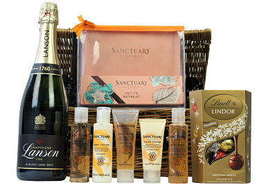 Never get tired of doing the little things that make you happy and give yourself an indulgent treat with the Sanctuary Spa Retreat Pamper Basket.Nestled inside this willow gift hamper basket the Sanctuary Spa products included allow you to re-create your own spa day at home and provide total relaxation. Pair this gift with the bottle of your choosing and a luxurious chocolate box from master chocolatiers Lindt and you have created a pampering gift for a delicious indulgent treat.