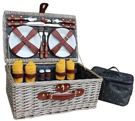 This fabulous fitted picnic basket comes in the option for two or four people. Elegant and stylish this handcrafted antique willow picnic basket is lined with a dark grey material complete with a stylish 'bug' pattern. The basket comes with its own handy cooler bag and is the perfect way to keep your food and drink fresh on those warm summer days. Complete with wood effect cutlery, porcelain plates, glasses, napkins and more, the only decision left to be made is what tasty treats to fill it with!