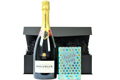 The Thank You Chocolates and Fizz gift box beholds a prestigious bottle of champagne or prosecco to accompany a book box of luxury chocolates from the House of Dorchester.  A delightful gift box to provide a big Thank You for someone special.