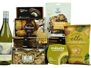 Delight your recipient by sending them The Stratford Gift Basket.  Add your preferred bottle or just savour this selection of gourmet delights foods alone.   Amazing foods from Superfoods Bakery, Deliciously Ella,  Positano to name but a few.  This hamper basket is packed full of deliciousness is the perfect treat for any loved one or colleague.