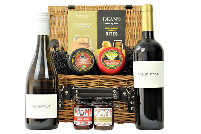Create a truly stunning gift within The Cheese and Wine Gift Basket. Pair your preferred wine duo with Award Winning Cheshire Cheese Co, waxed cheese truckles, flavoursome chutney, Verduijn's artisan wafer crackers and Deans mature cheddar bites. A delicious gift presented within a willow gift hamper basket.