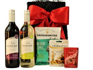 The House Wine Gift Tray contains two bottles of Silver Bay Point's wine to compliment a selection of deliciously tasty snacks and treats. These brilliant big-hearted British wines will show the rest of the world how to party. Both bottles are easy drinking in style and perfectly complement most tastes and moods. Presented within in a black tray and finished with a red satin bow.