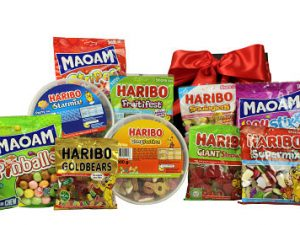 The happy world of Haribo in a gift box! Within our black lidded box beholds kids and grown ups favourites alike. A delicious assortment of Haribo fruity jelly and Maoam chewy sweets. So if your favourites are the Tangfastics or the Giant Strawbs, the Supermix or the Gold Bears we have something to please one and all.